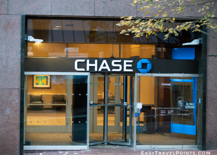 Chase bank office branch entrance in downtown with a logo on top.
