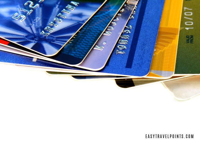 several multi-colored credit cards fanned out and a beginner's guide to credit card points