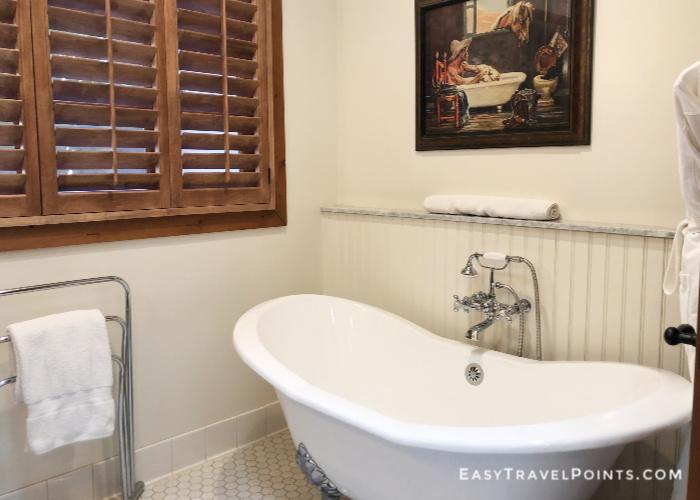 a clawfoot bathtub inside a hotel room bathroom