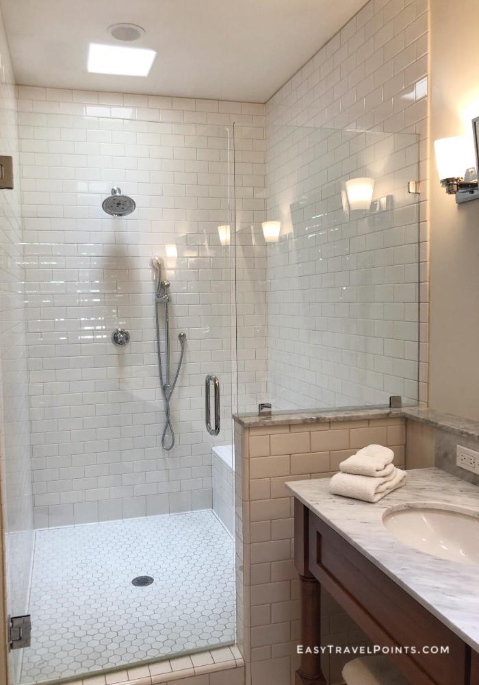 a walk in shower in a hotel bathroom