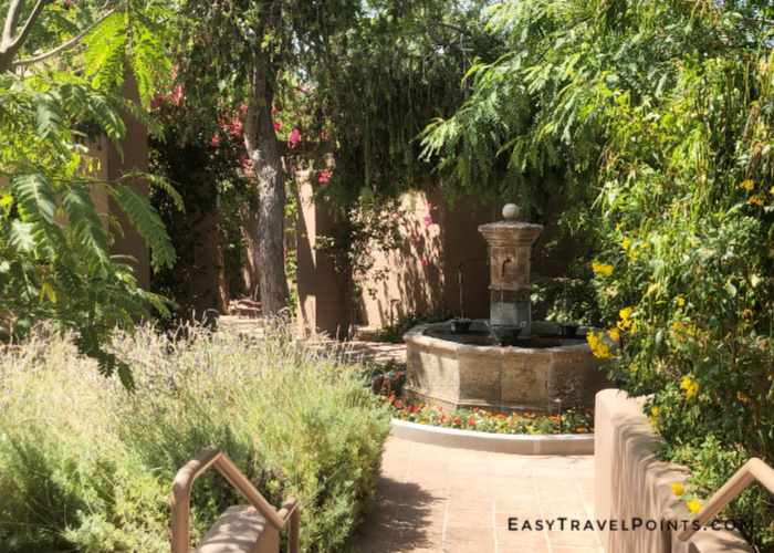 a walkway to the casitas at the Hermosa Inn