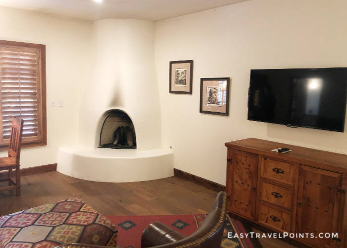 a fireplace in the corner of a hotel room
