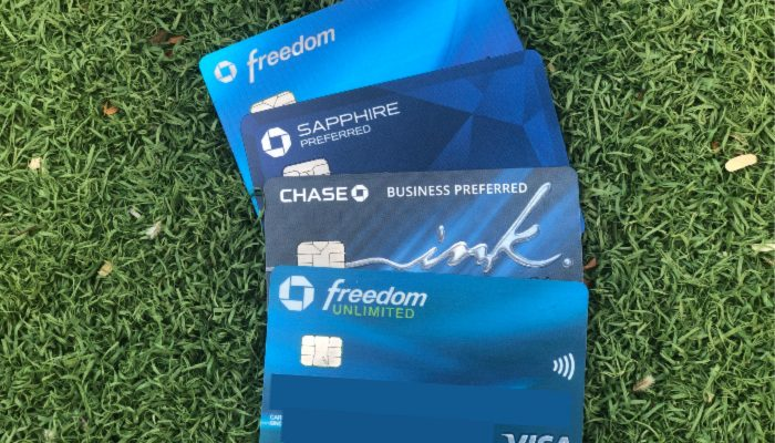 the Chase sapphire preferred, freedom, freedom unlimited and ink business preferred credit cards fanned out over a green background