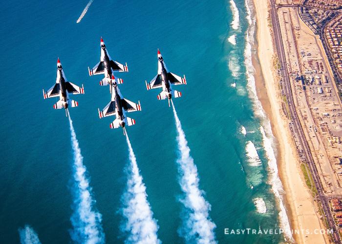 4 USAF Thunderbird F-16s flying over Huntington Beach