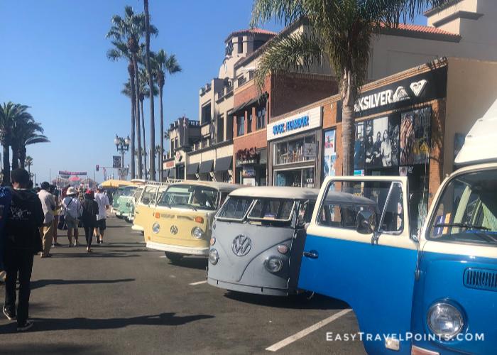 VW buses lined up along Main Street Huntington Beach