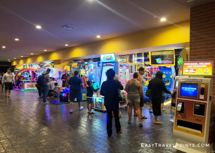 people standing in the arcade at the great wolf lodge anaheim