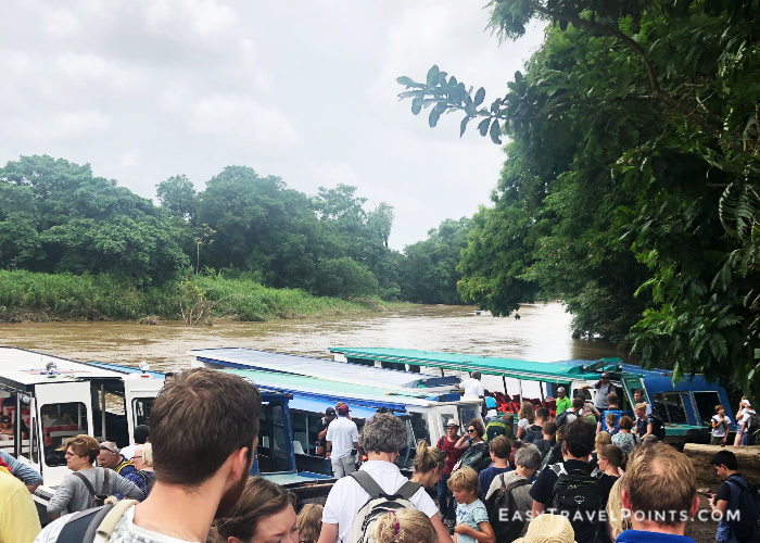 people getting on a river boat in Costa Rica