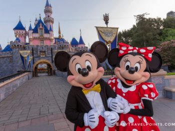 Mickey and Minnie Mouse in front of Cinderella's castle at Disneyland