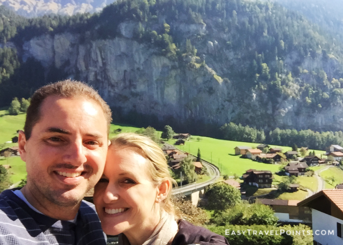 an attractive couple with Lauterbrunnen village behind them