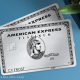 American Express platinum cards on a blue background