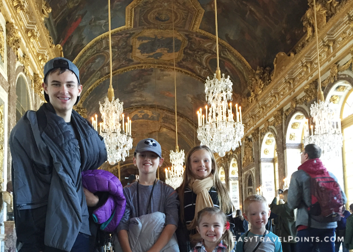 a cute family in the Hall of Mirrors Versailles
